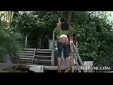 Gorgeous MILF plays with pierced tits outdoor